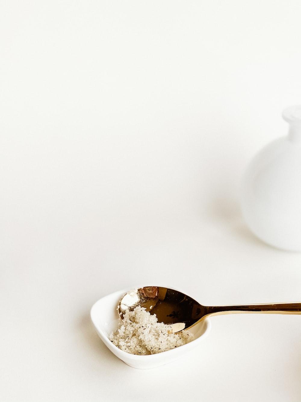 white ceramic teapot on white ceramic bowl