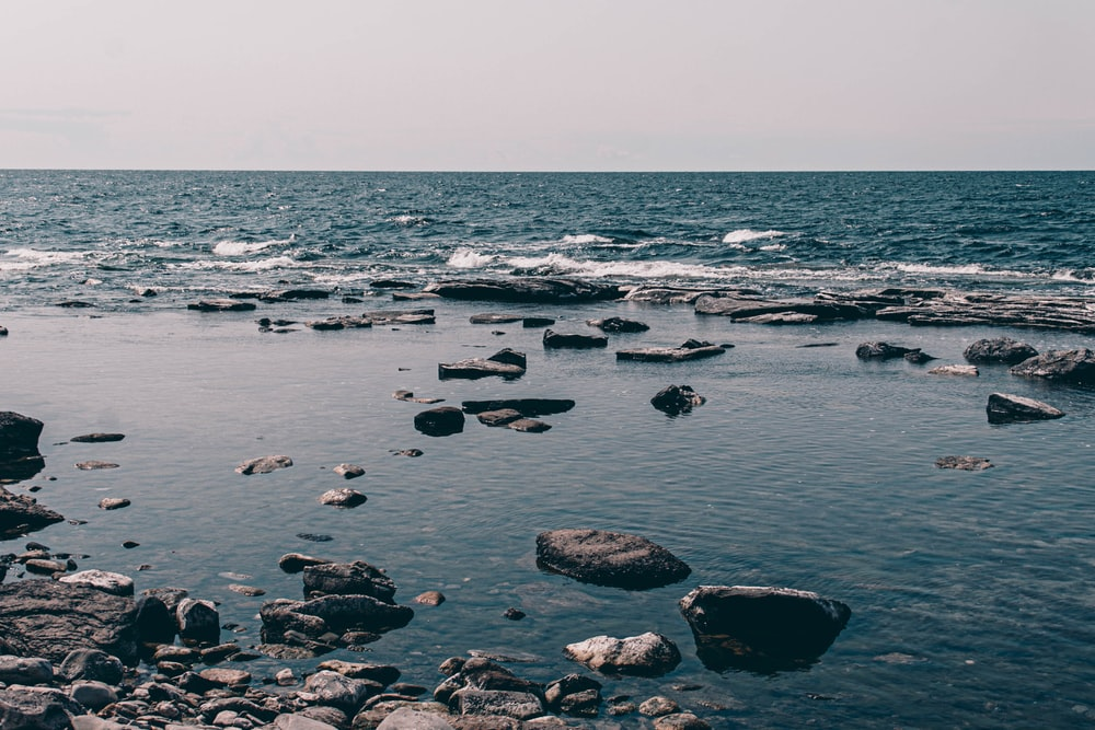 rocks on body of water during daytime