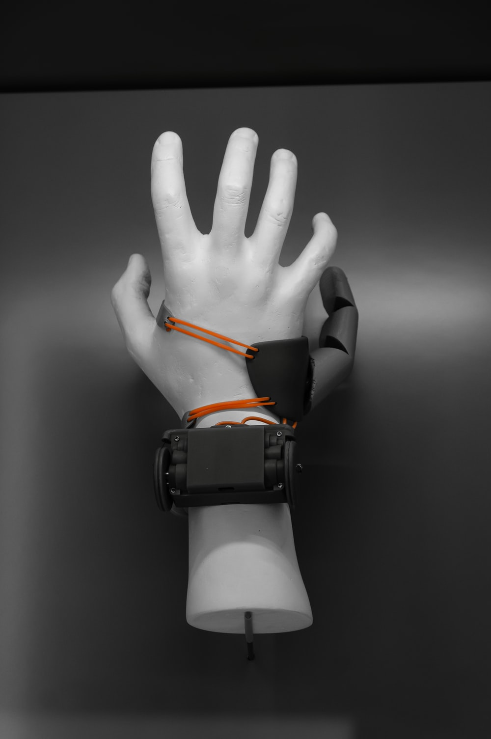 person wearing black and orange watch