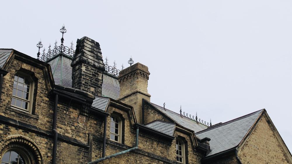 brown brick building under white sky during daytime