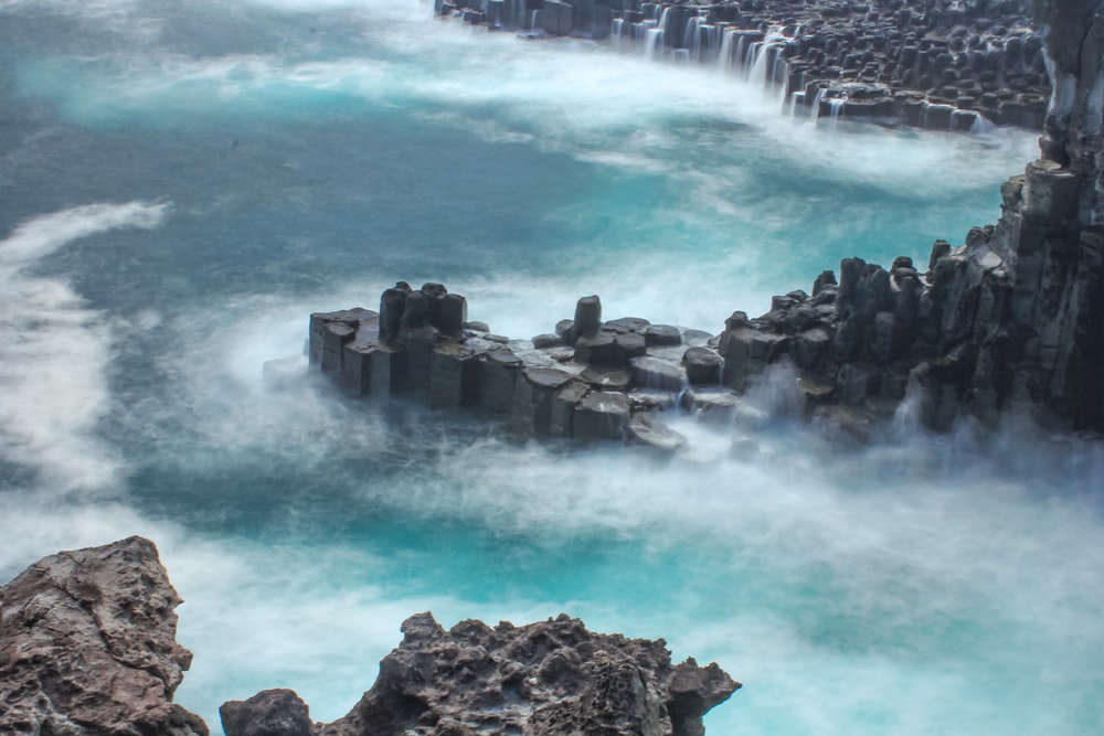 brown rocks on water falls