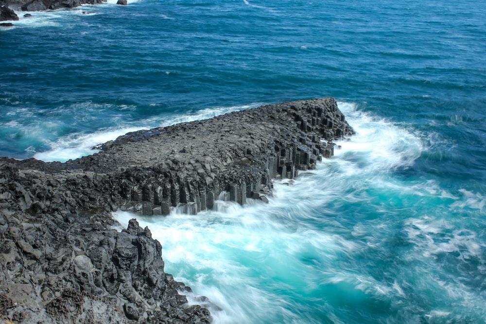 water waves hitting the rocks