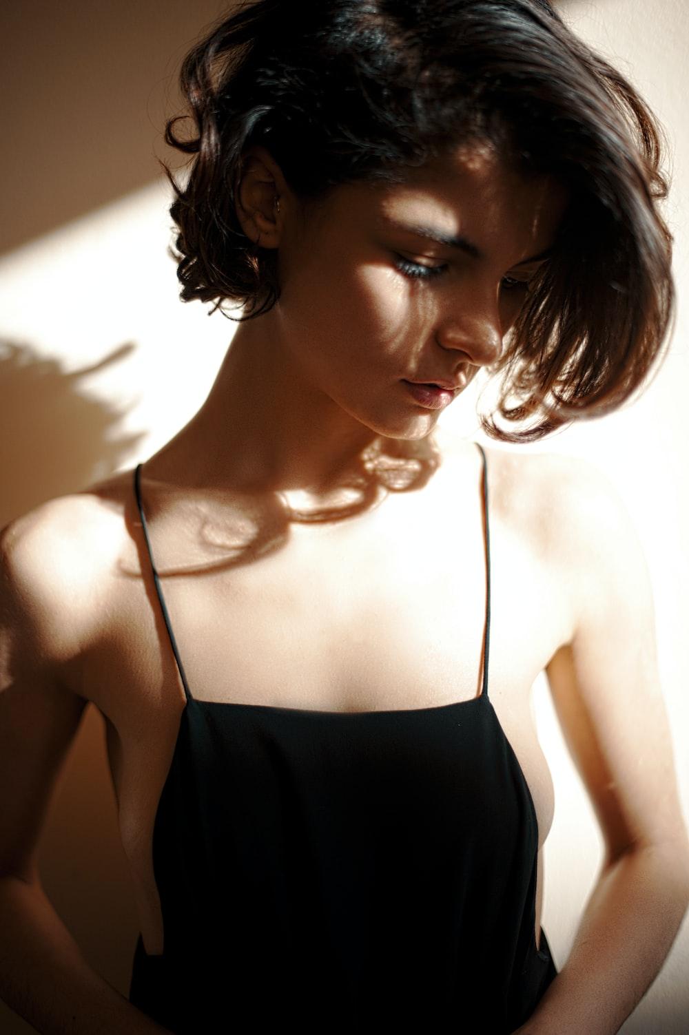 woman in black spaghetti strap top