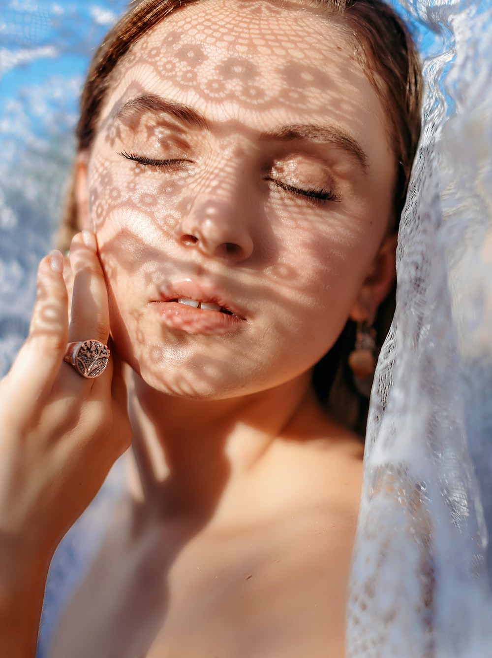woman with white veil and silver ring