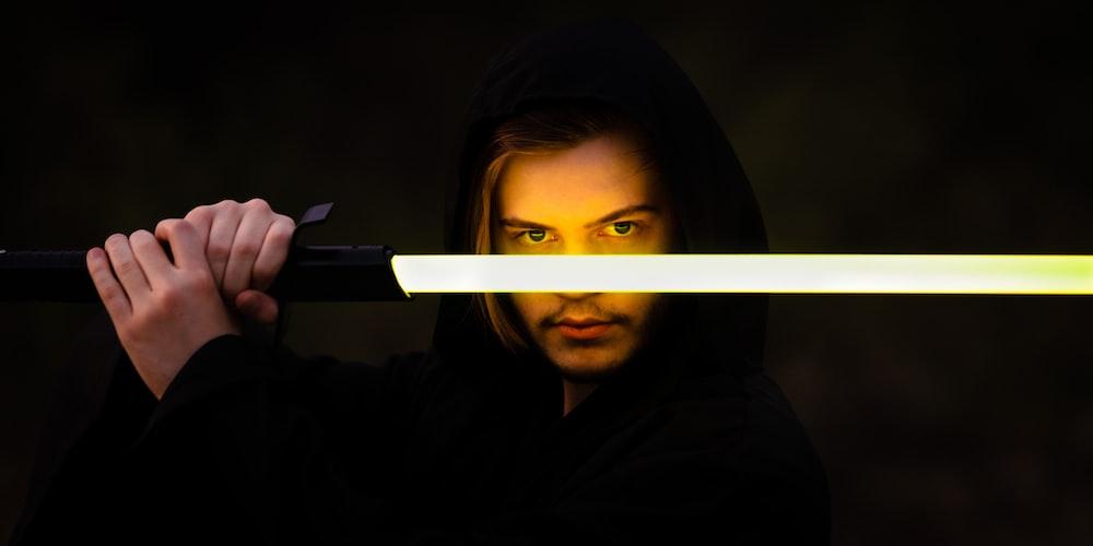 woman in black hoodie holding pen