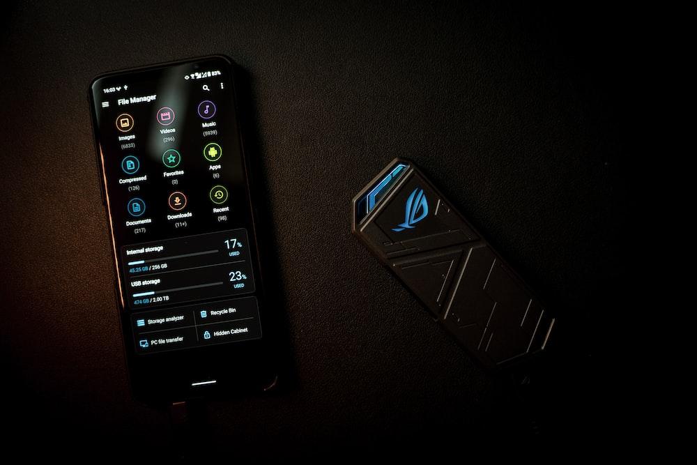 black samsung remote control on black textile