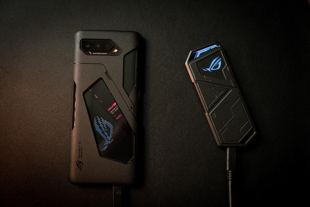 black smartphone on black textile