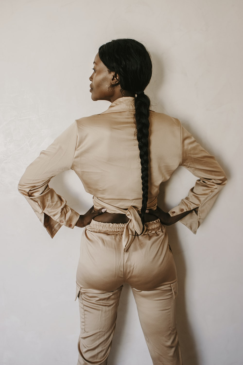woman in white long sleeve shirt and brown pants