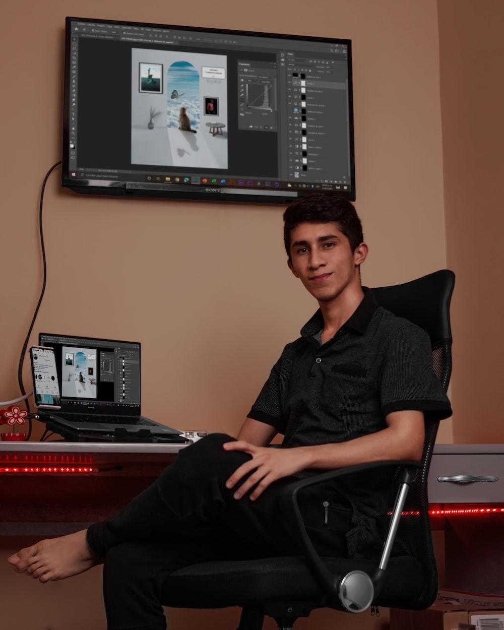 man in black dress shirt sitting on black office rolling chair