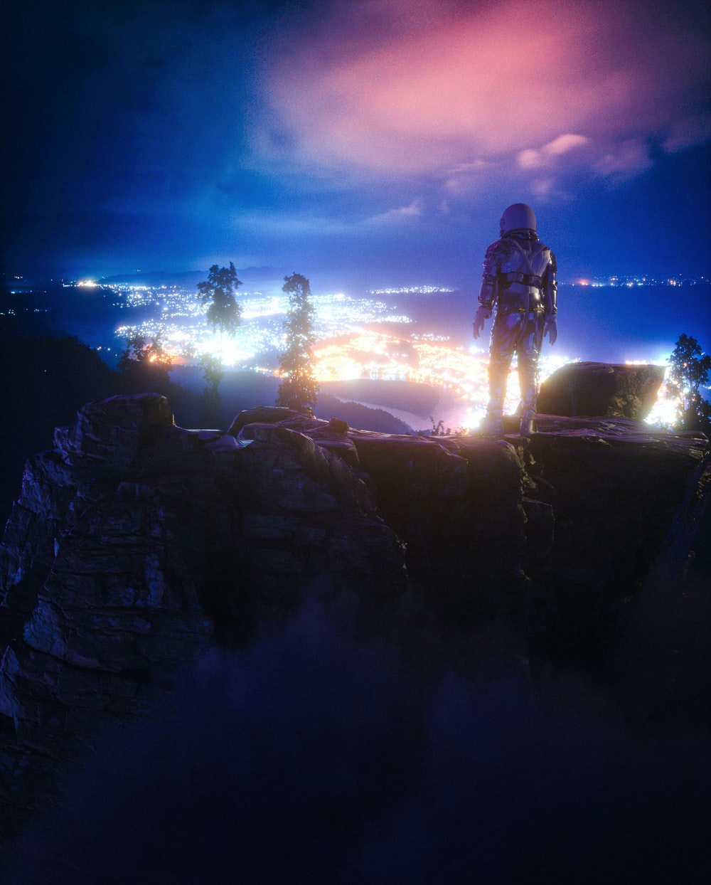 man standing on rock formation during night time