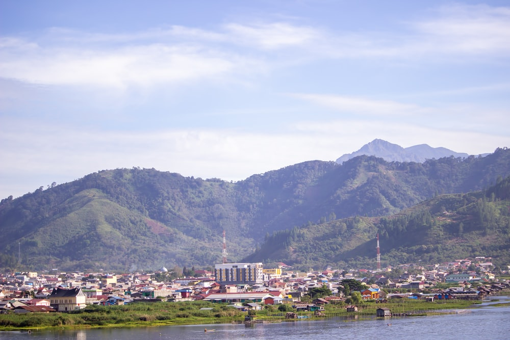 city near mountain during daytime