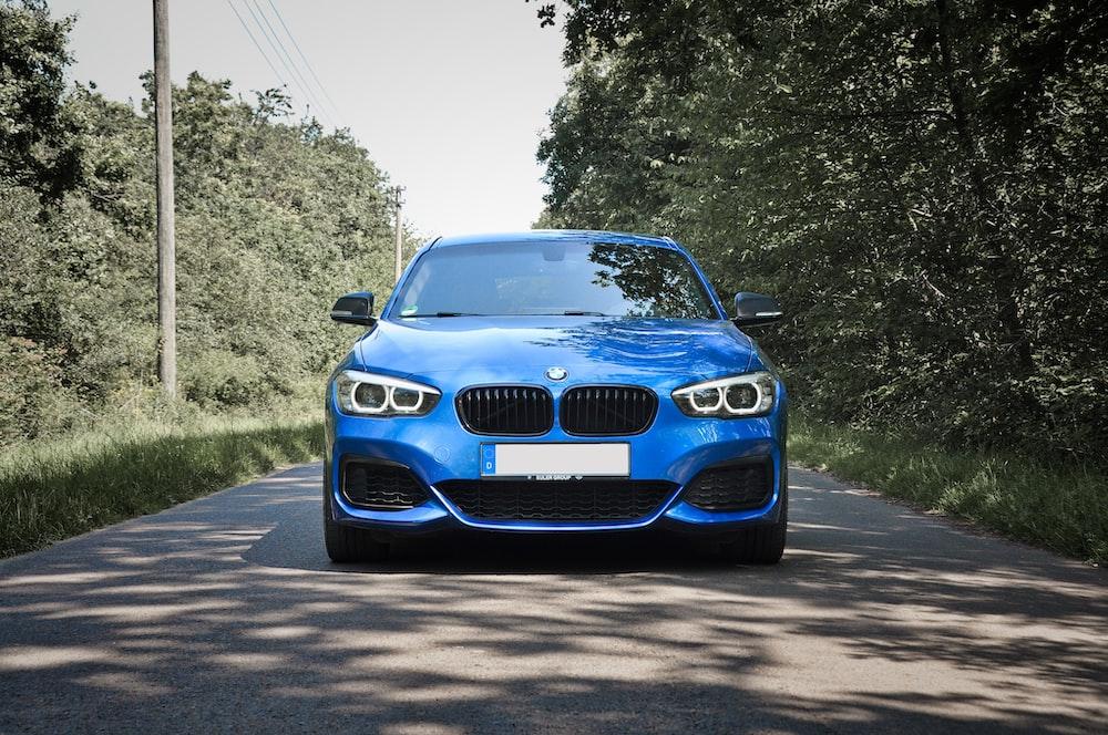 blue bmw car on road during daytime