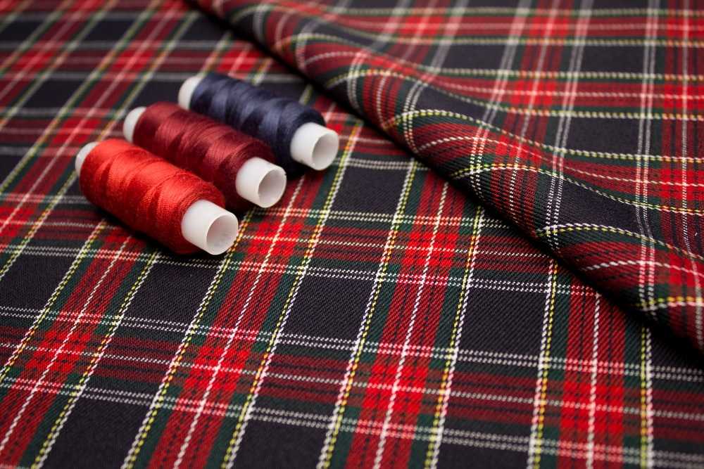 red and white thread on red and white plaid textile