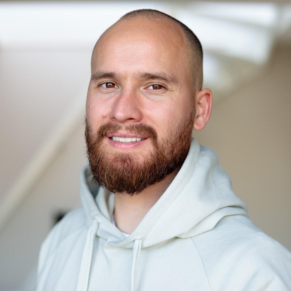 man in white hoodie smiling