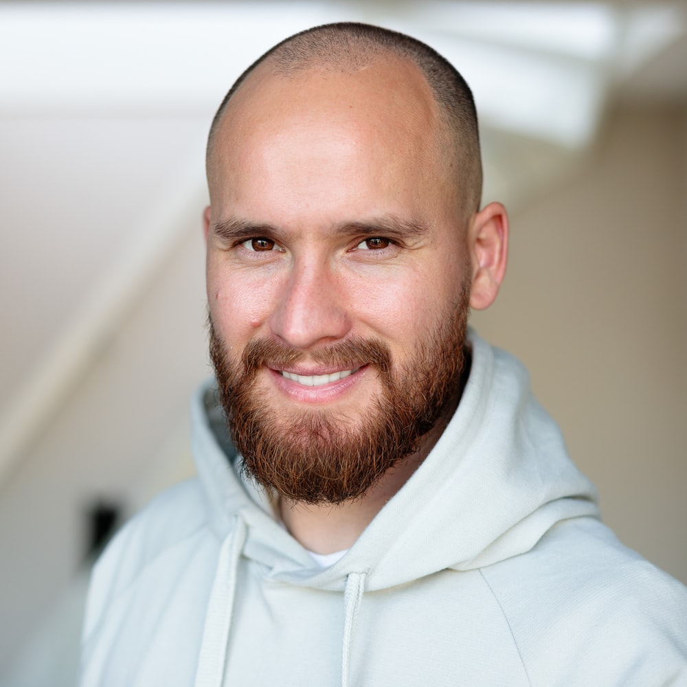 man in white pullover hoodie smiling