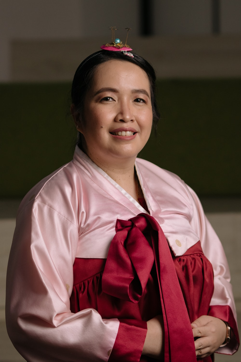 woman in pink robe smiling