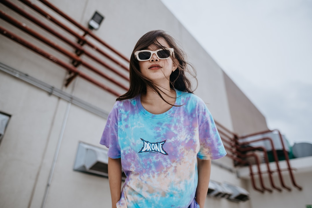 Girl In Purple and Blue Crew Neck T-Shirt Wearing Brown Sunglasses - unsplash