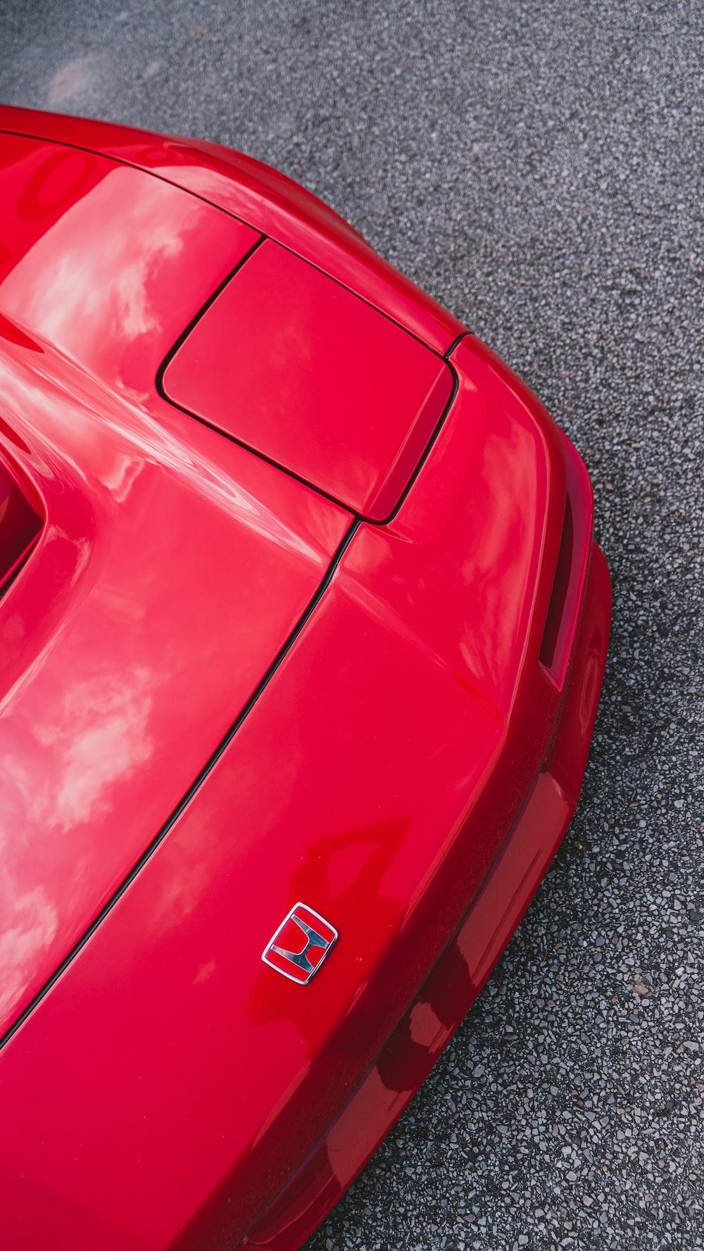 red porsche 911 on grey concrete pavement