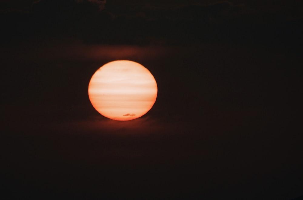orange round light on dark room