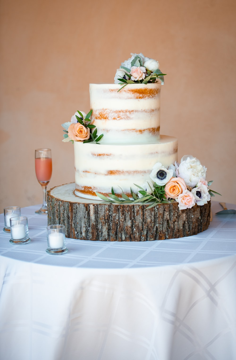 white and brown cake on brown woven tray