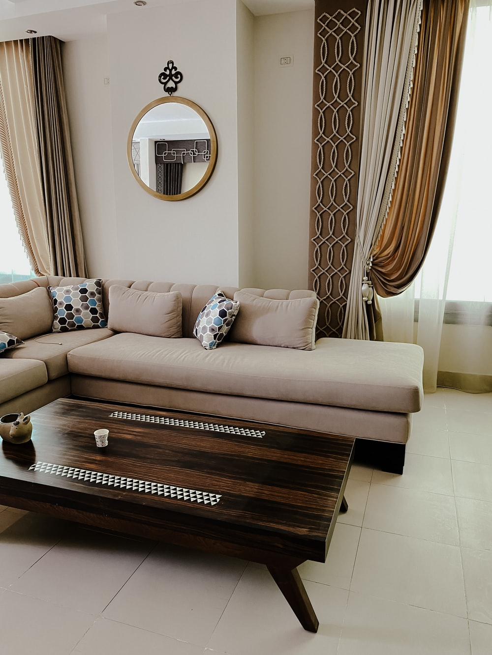 brown wooden bed frame with white and brown floral sofa