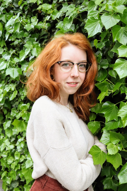 woman in white sweater wearing eyeglasses