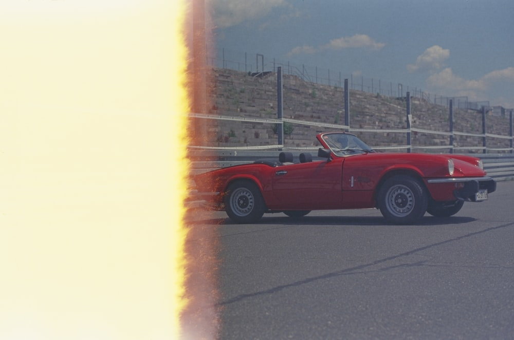 red chevrolet camaro on road during daytime