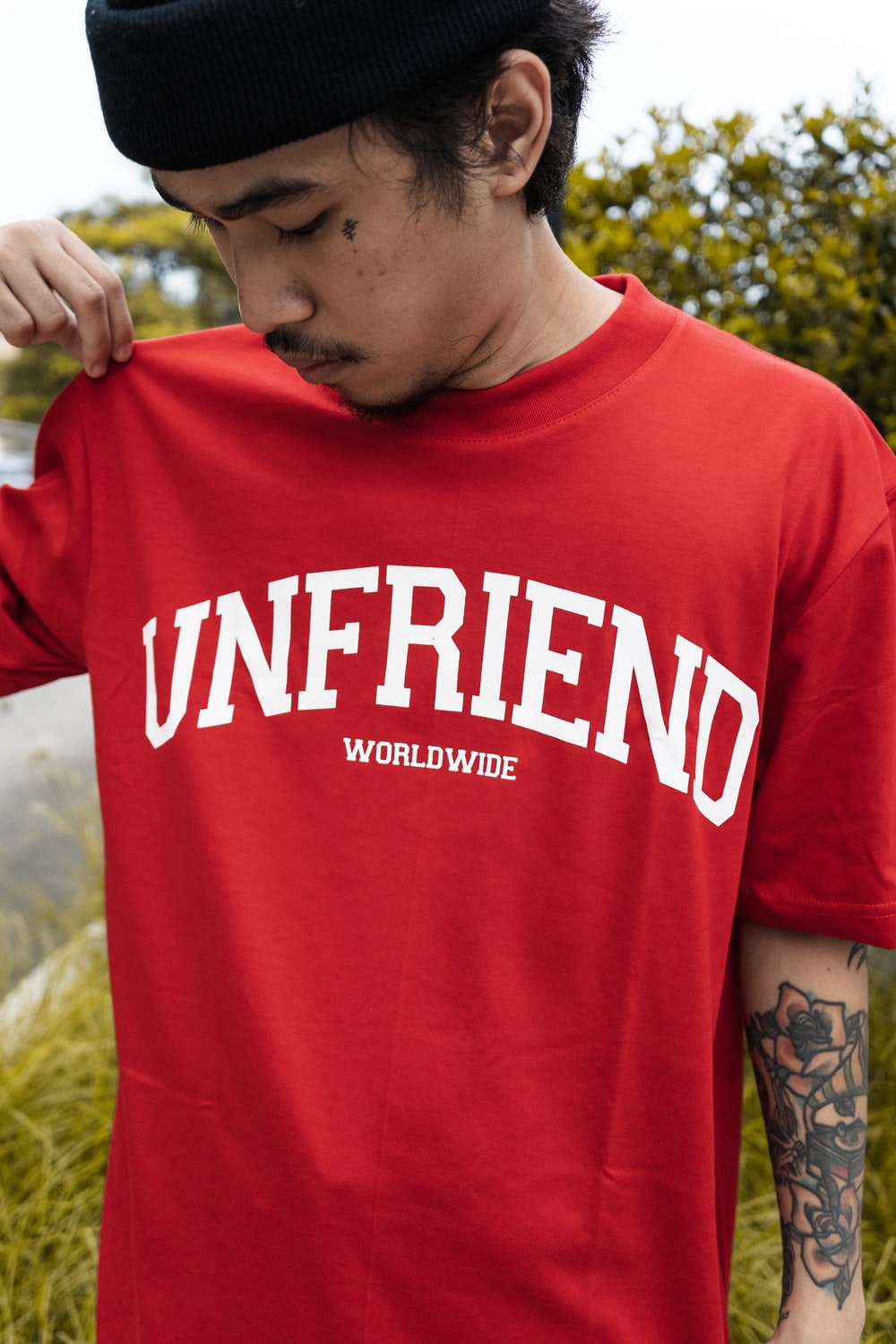 man in red and white crew neck t-shirt