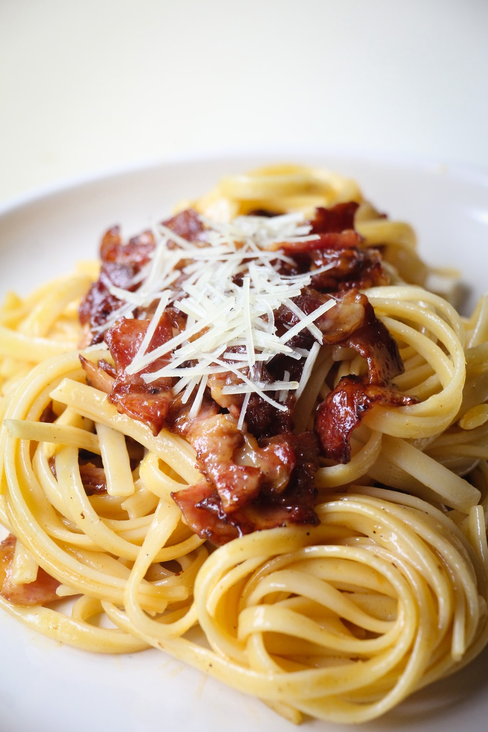 pasta with meat on white ceramic plate