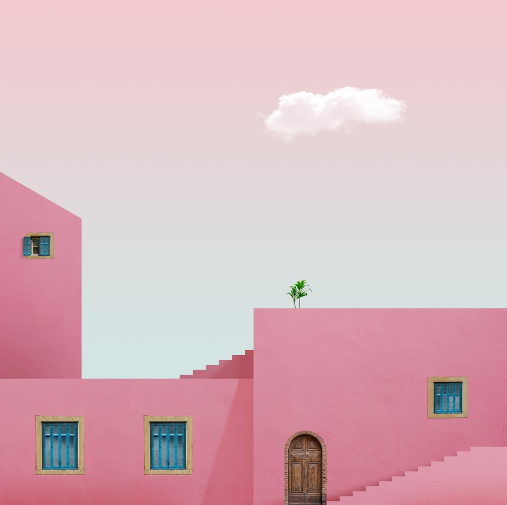 pink and blue concrete building under white sky during daytime