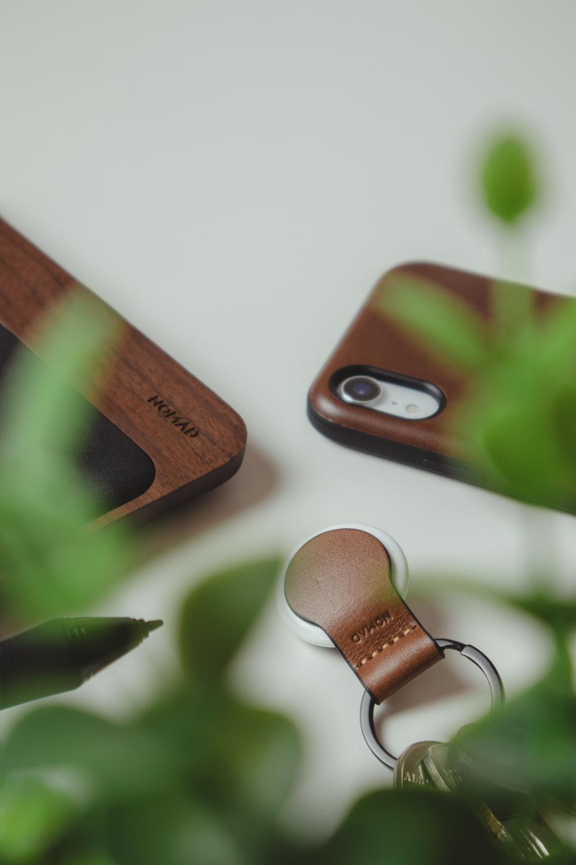 silver padlock on brown wooden board
