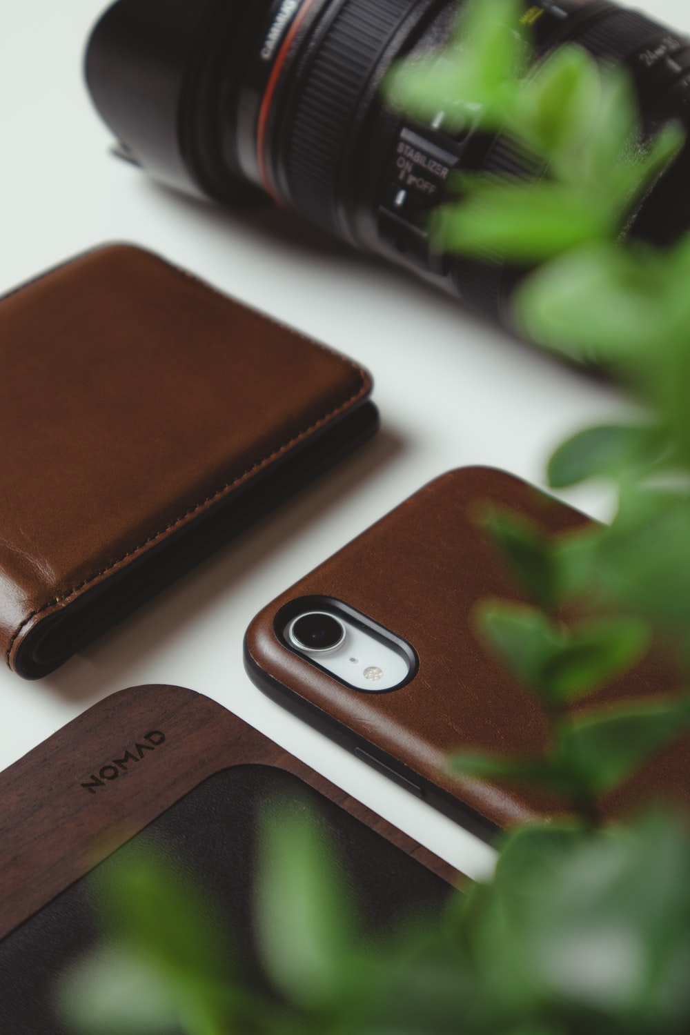 silver iphone 6 beside brown leather bifold wallet