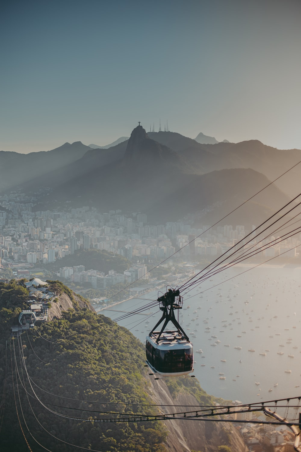 black cable car over the city during daytime
