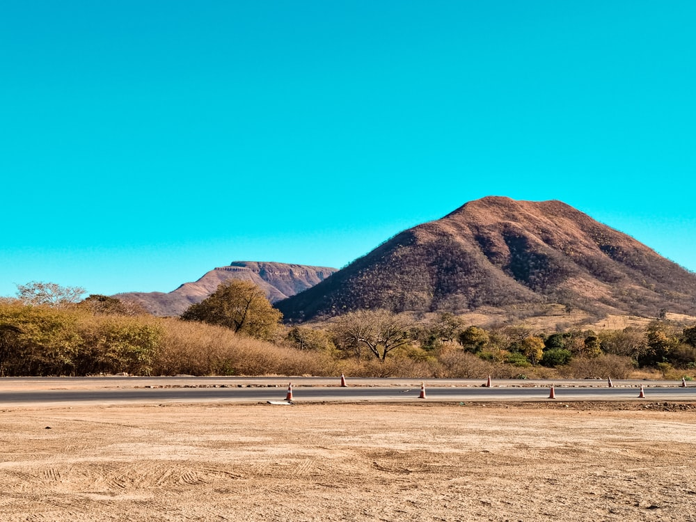 green and brown mountains under blue sky during daytime