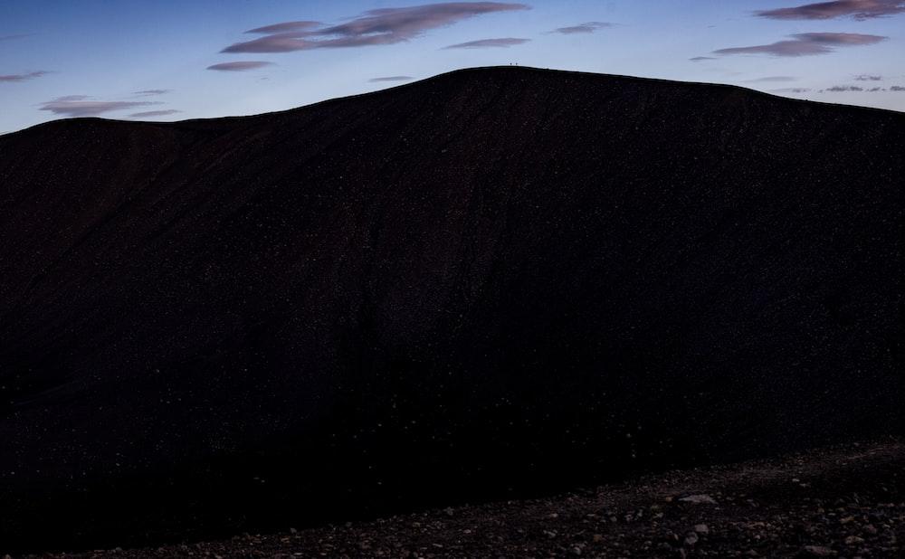 black mountain under blue sky during daytime