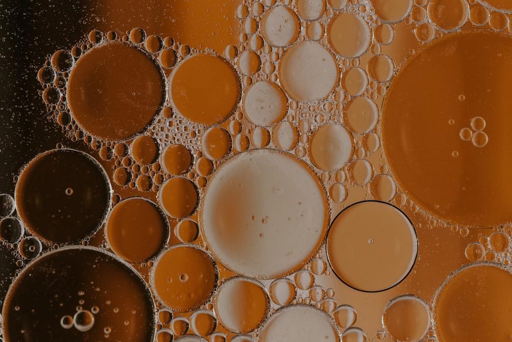 brown liquid in clear glass
