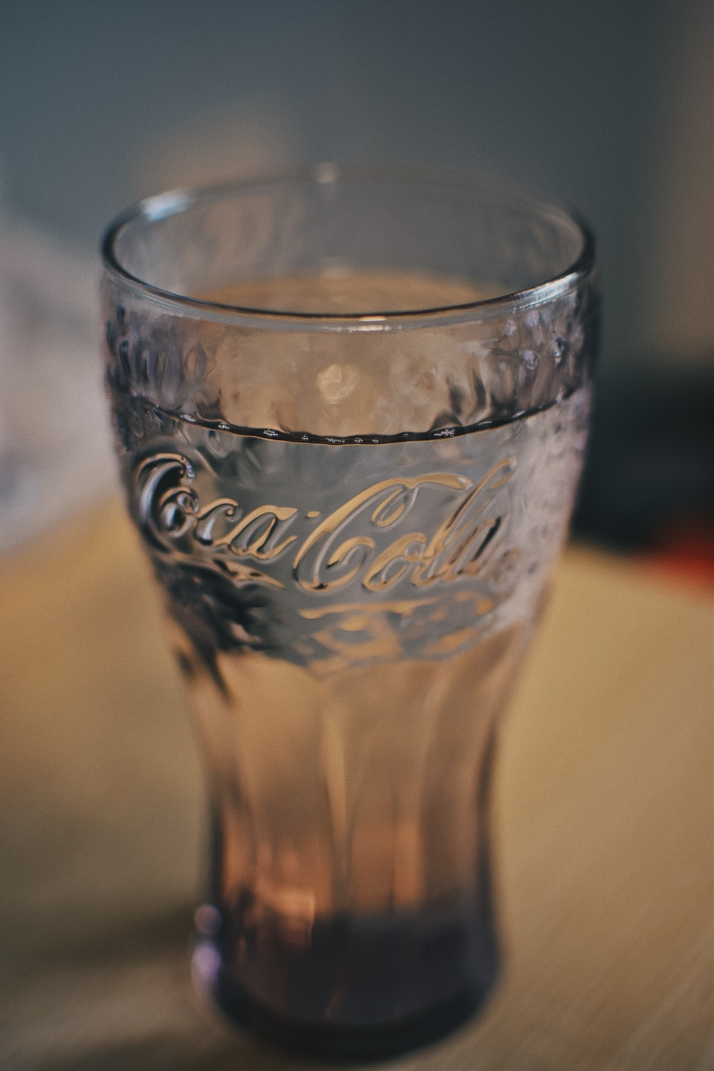 coca cola drinking glass on brown table