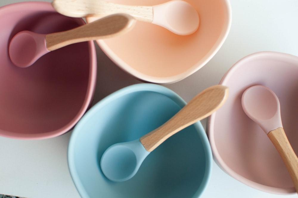 brown wooden spoon in blue ceramic bowl