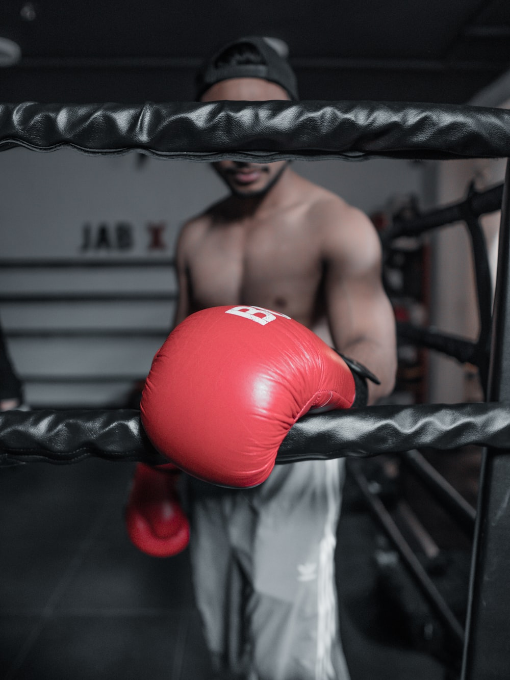 topless man in red boxing gloves