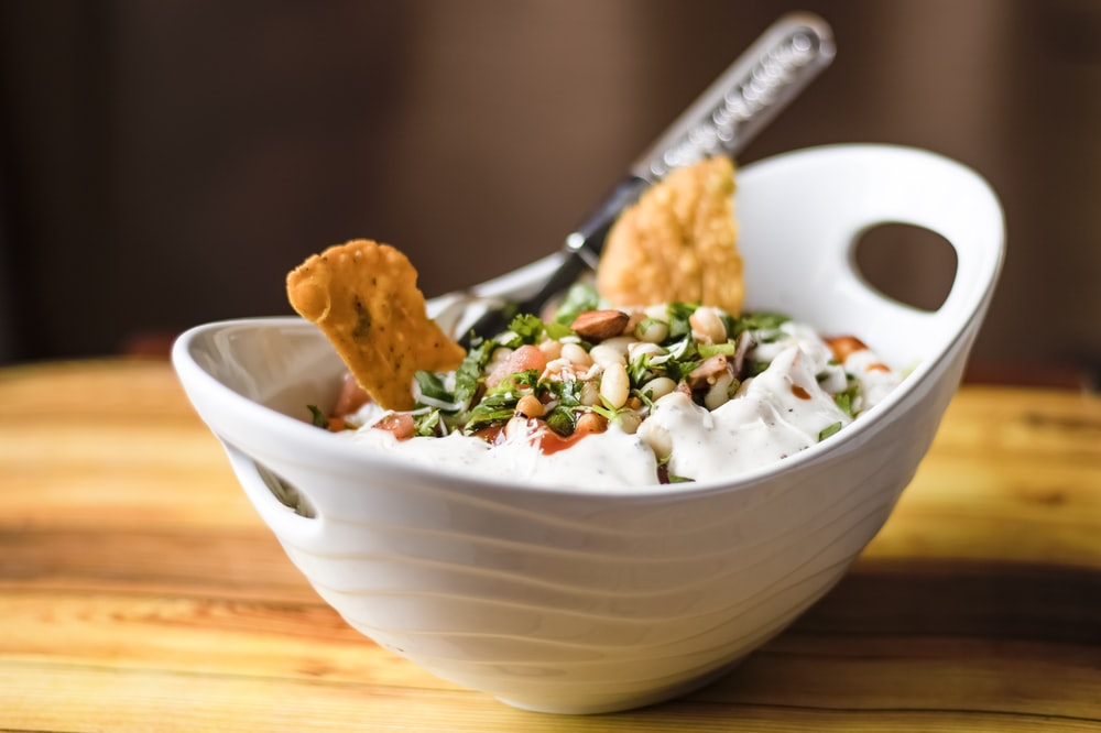 white ceramic bowl with food