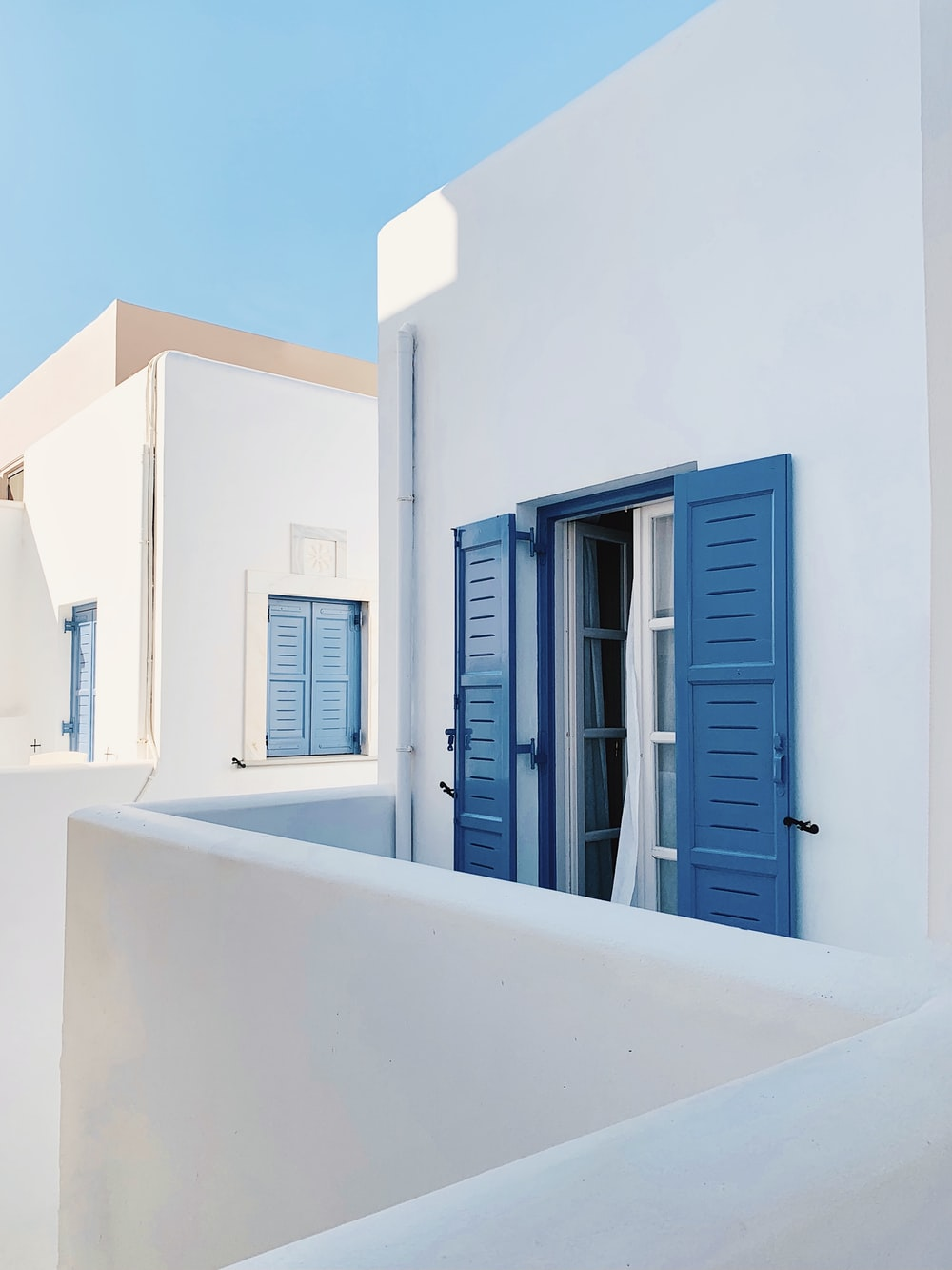white and blue wooden window