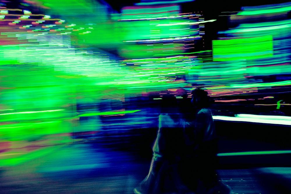 man and woman walking on street during daytime