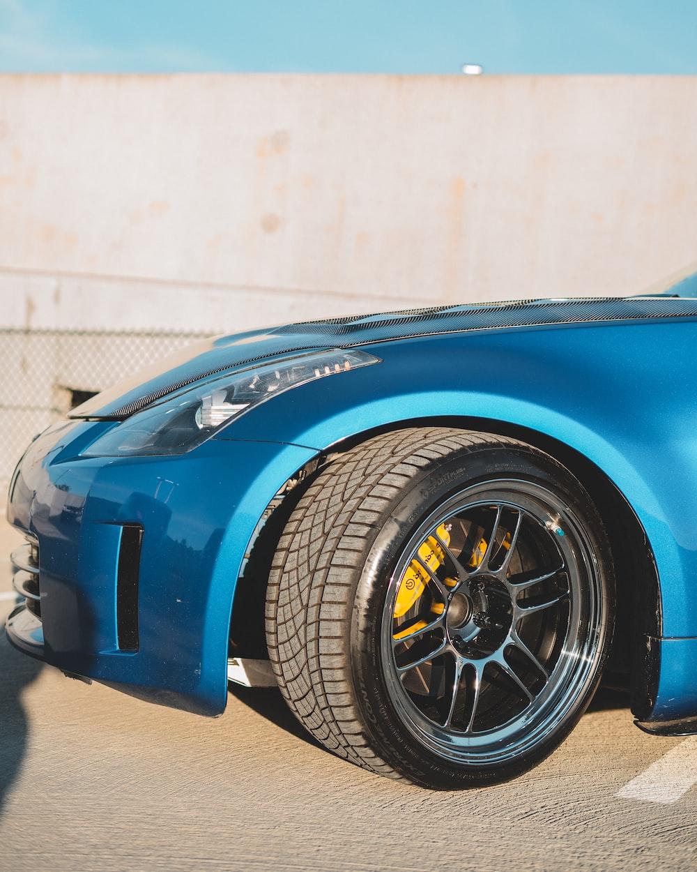 blue ferrari car in a garage