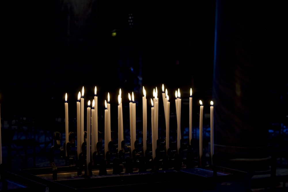 lighted candles on blue surface