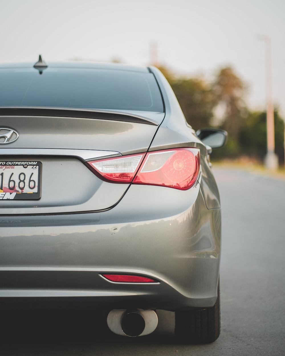 gray honda car on road during daytime