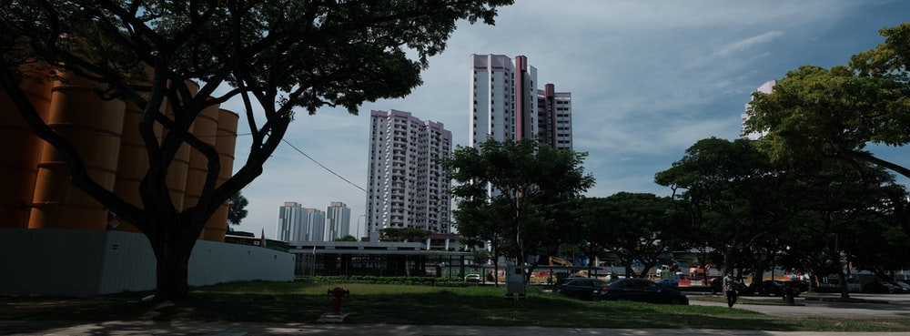 green grass field near high rise buildings during daytime