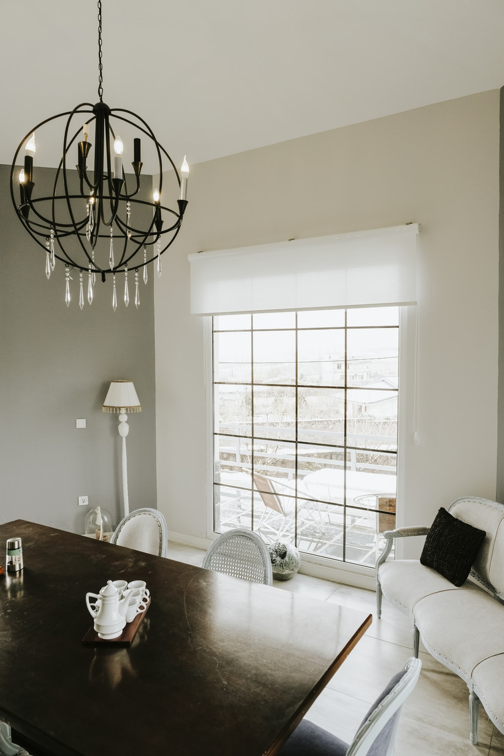white table lamp on table