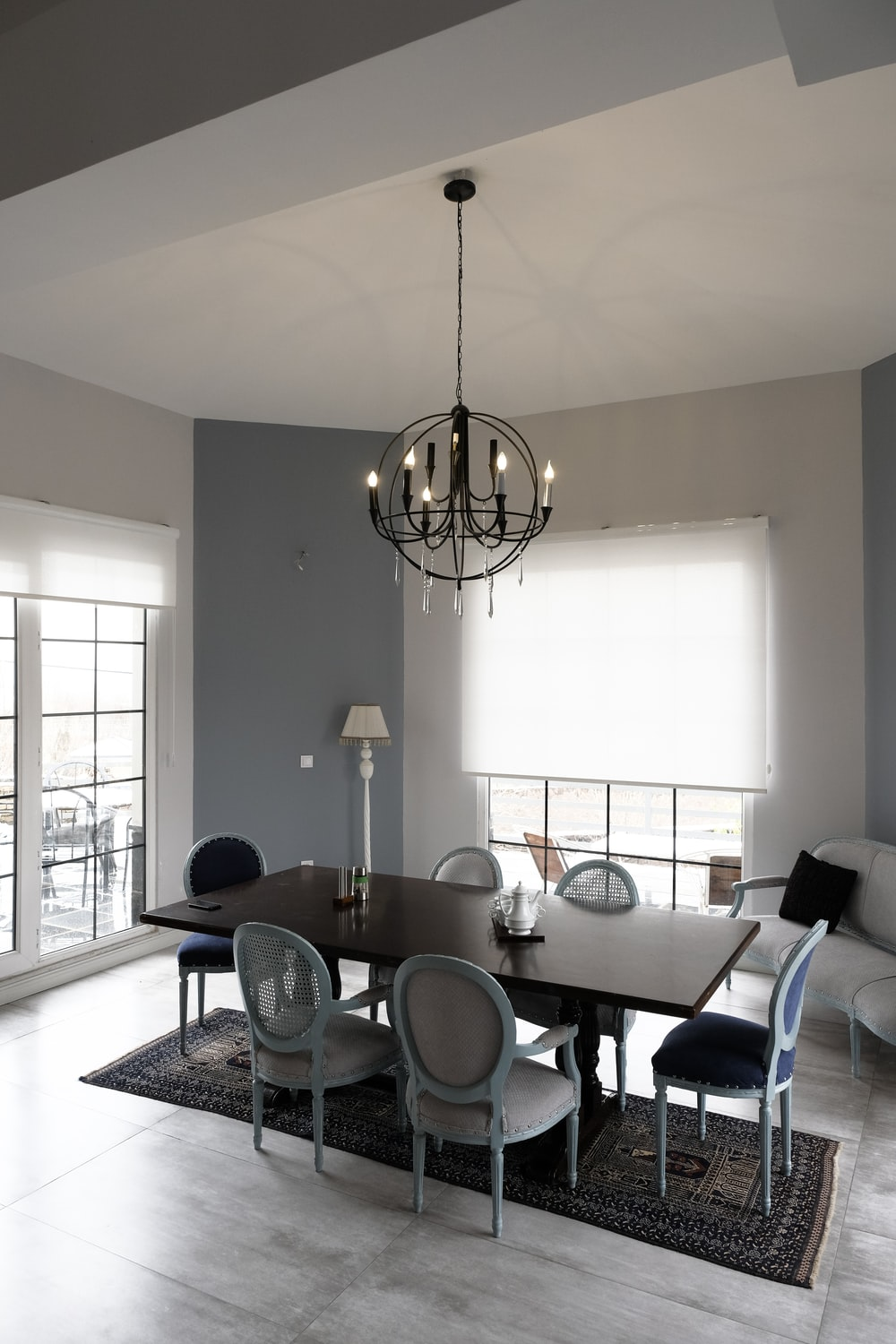 white and black dining table and chairs