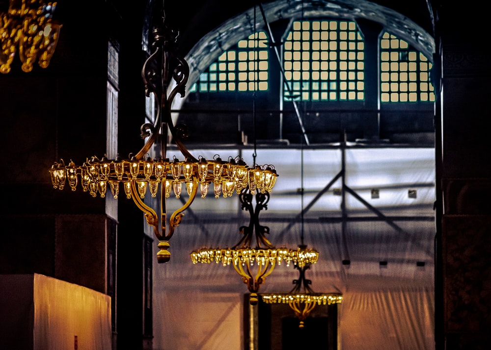 brass uplight chandelier inside building