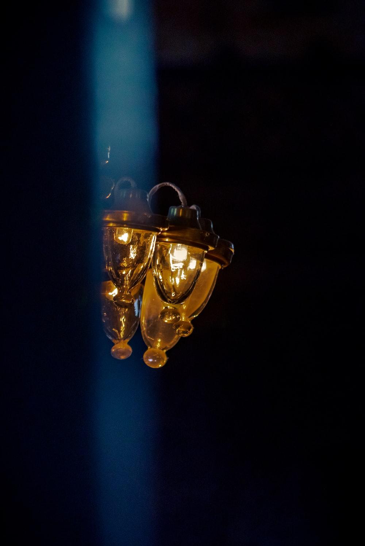 brass and blue light bulb